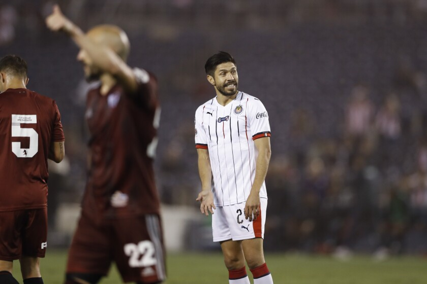 Chivas forward Oribe Peralta, right, reacts during the second half of a Colossus Cup soccer match against River Plate Friday, June 28, 2019, in San Diego. (AP Photo/Gregory Bull)