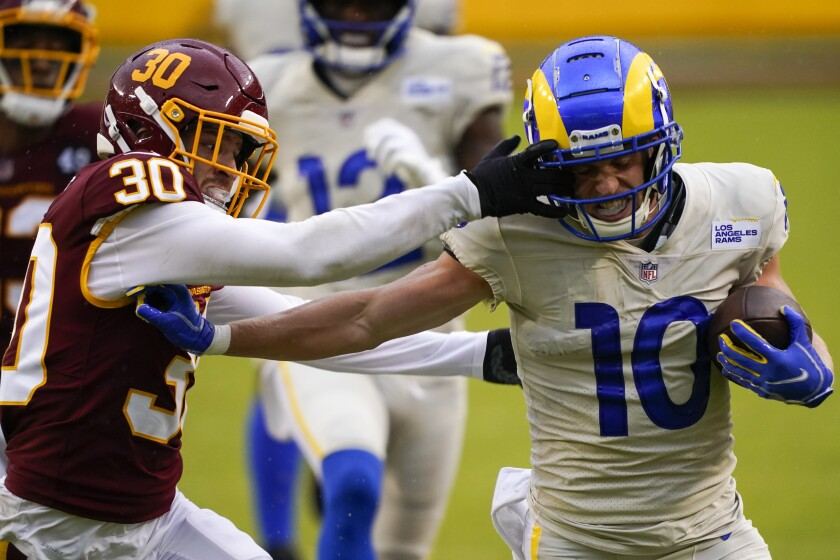 Los Angeles Rams' Cooper Kupp tries to get past Washington Football Team's Troy Apke during the second half of an NFL football game Sunday, Oct. 11, 2020, in Landover, Md. (AP Photo/Susan Walsh)