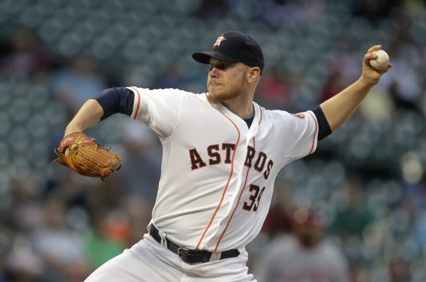 Houston Astros pitcher Brett Oberholtzer throws during the first inning of a baseball game against the Washington Nationals, Wednesday, April 30, 2014, in Houston. (AP Photo/Patric Schneider)