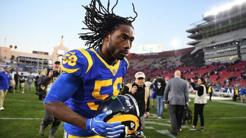 Rams' Cory Littleton runs off the field after a home victory over the San Francisco 49ers last season.