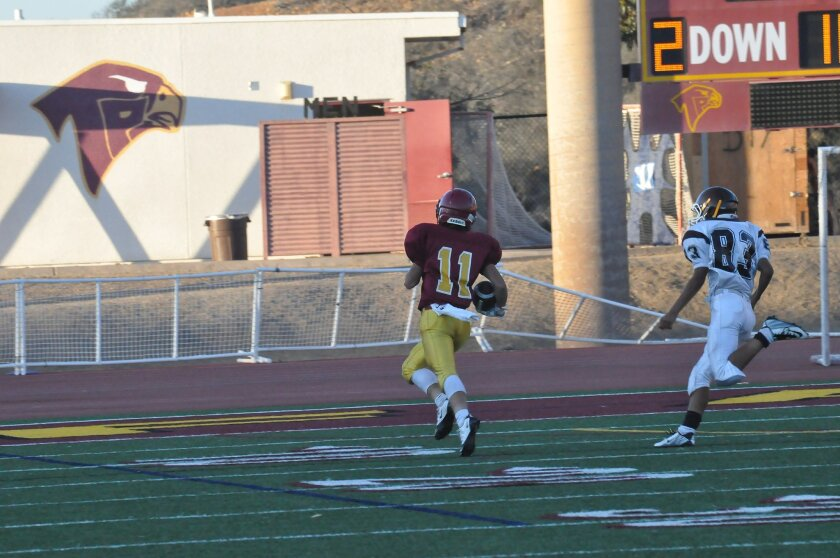 Sully O'Brien runs 82 yards for a touchdown. Photos by Claudia Perrone