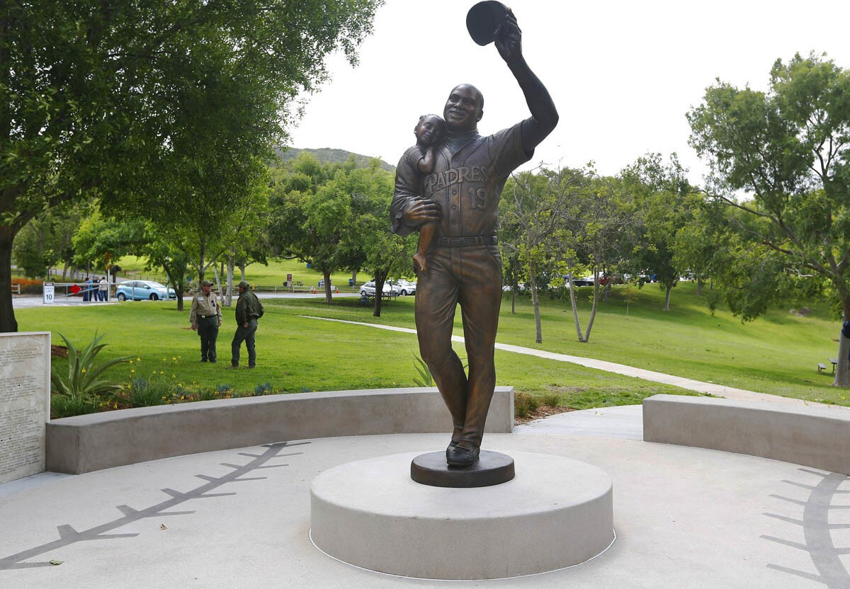 The Tony Gwynn Memorial Statue was dedicated at the Lake Poway Ballfield on May 9, 2017. The 11-foot bronze statue shows the Padres great holding his daughter Anisha Nicole. (Photo by K.C. Alfred/The San Diego Union-Tribune)
