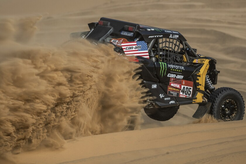 Driver Casey Currie and co-driver Sean Berriman race their Can-Am during Stage 8 of the Dakar Rally.