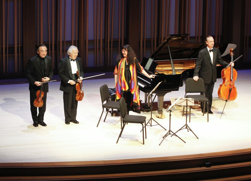 Quartet members (from left) Cho-Liang Lin (violin), Heiichiro Ohyama (viola), Wu Han (piano), and David Finckel (cello) take a bow after their performance at the gala opening concert of the La Jolla Music Society's new $82 million Conrad Prebys Performing Arts Center April 5 in La Jolla.