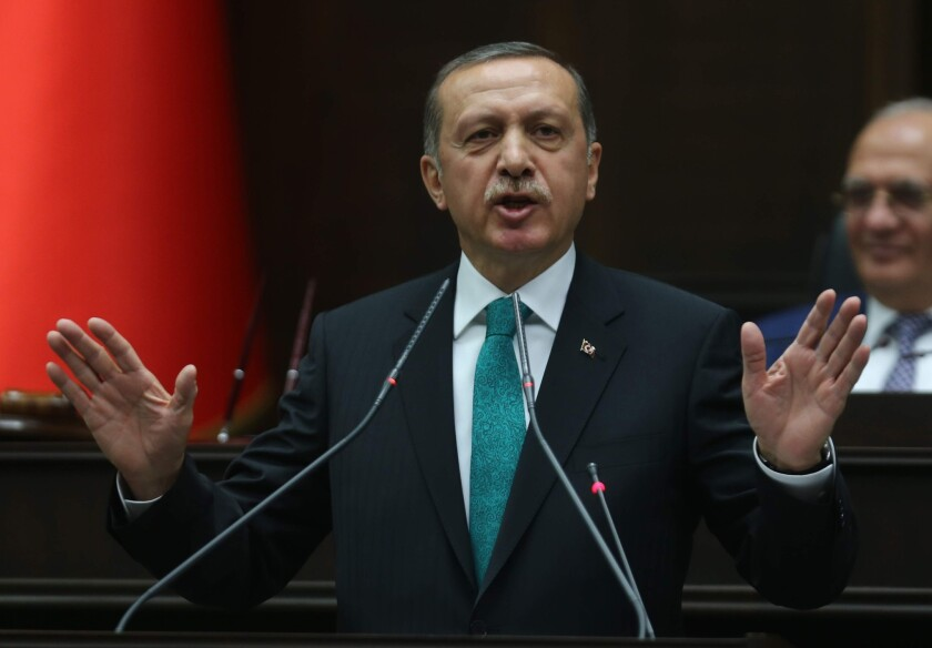 Turkish Prime Minister Recep Tayyip Erdogan delivers a speech to the members of the parliament in Ankara.