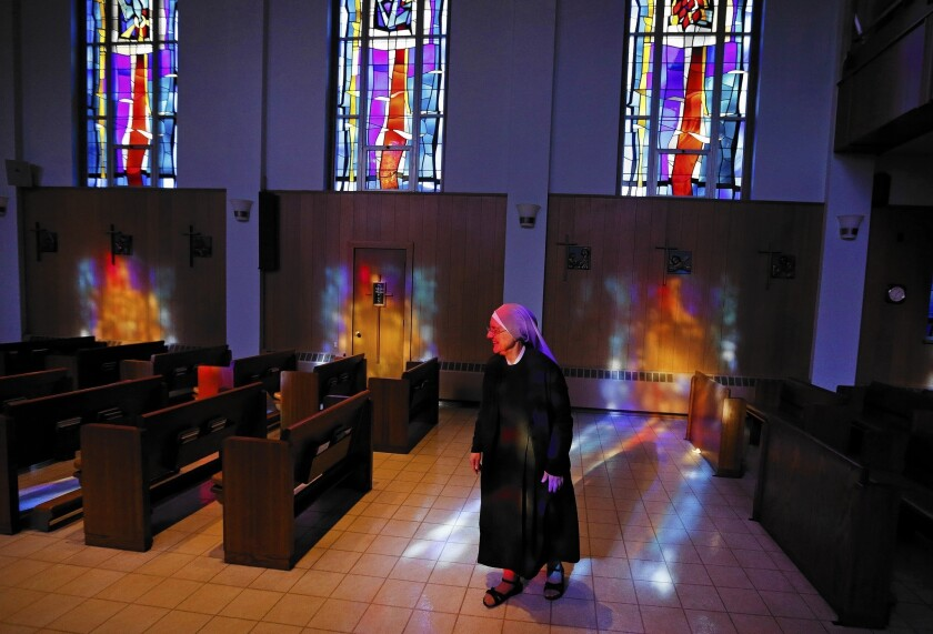 Mother Patricia Mary walks in the chapel at the Mullen Home for the Aged, run by Little Sisters of the Poor, in Denver, Colo. Nuns have a substantially higher risk of reproductive cancers than women who have children.
