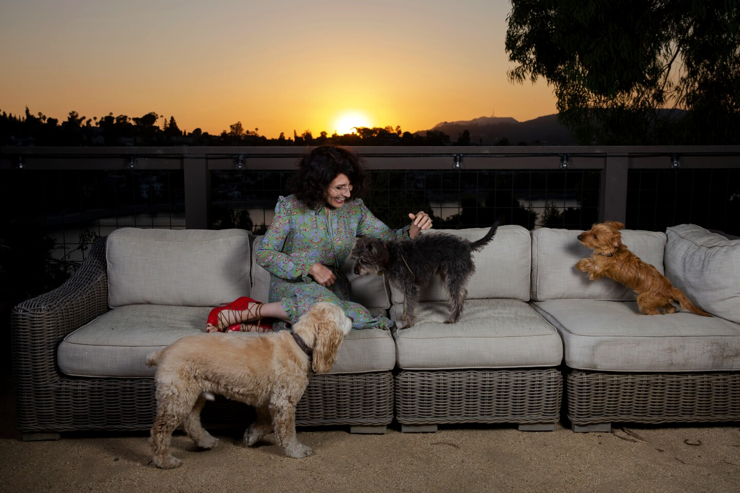 Actress Lisa Edelstein and her pets enjoy her back patio that overlooks the Silver Lake reservoir.