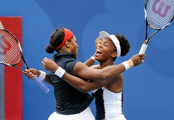 Serena Williams, left, and her sister, Venus, celebrate winning the gold medal in doubles at Beijing, after beating Anabel Medina Garrigues and Virginia Ruano Pascual of Spain. The sisters also won the gold in the event at the Sydney Games.