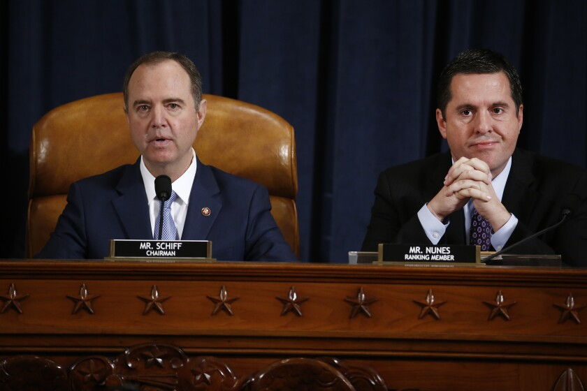 Chairman Adam Schiff speaks as ranking Republican Devin Nunes listens during the House Intelligence Committee impeachment hearing on Nov. 21.