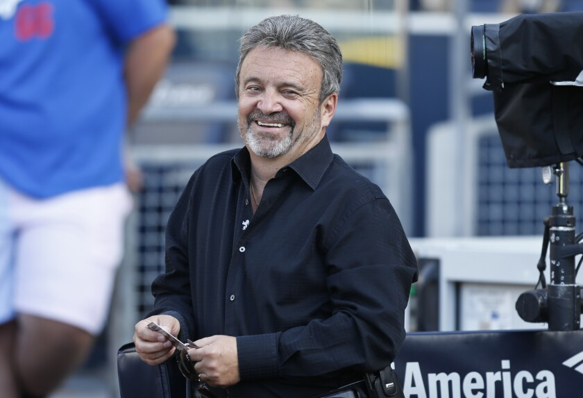 Former Dodgers general manager Ned Colletti has a new gig as a hockey scout for the San Jose Sharks.