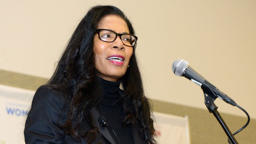 Judy Smith speaks into a microphone