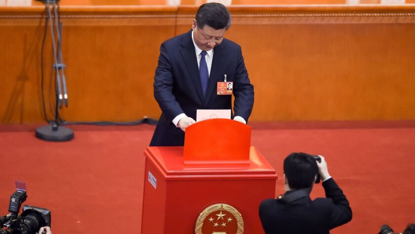 Chinese President Xi Jinping votes at the Great Hall of the People in Beijing.