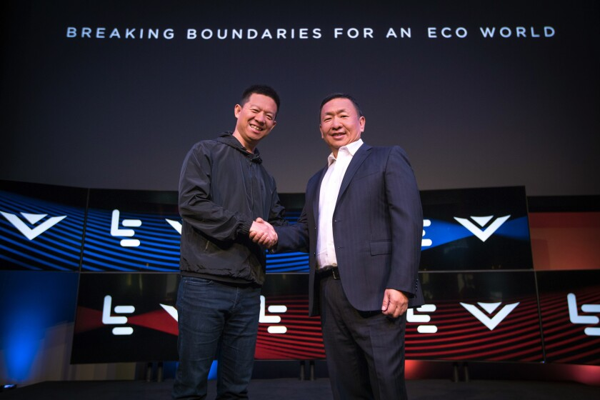 LeEco Chief Executive Jia Yueting, left, and Vizio CEO William Wang shake hands after announcing the acquisition of the Irvine TV maker last week.