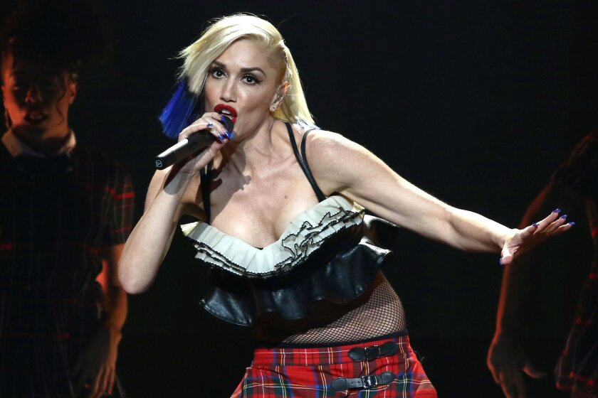 FILE - In this Oct. 17, 2015, file photo, Gwen Stefani performs during an exclusive concert for MasterCard cardholders at the Hammerstein Ballroom in New York. Recently divorced singer Blake Shelton and Stefani, who filed for divorce in August, are dating. A representative for Shelton confirmed on