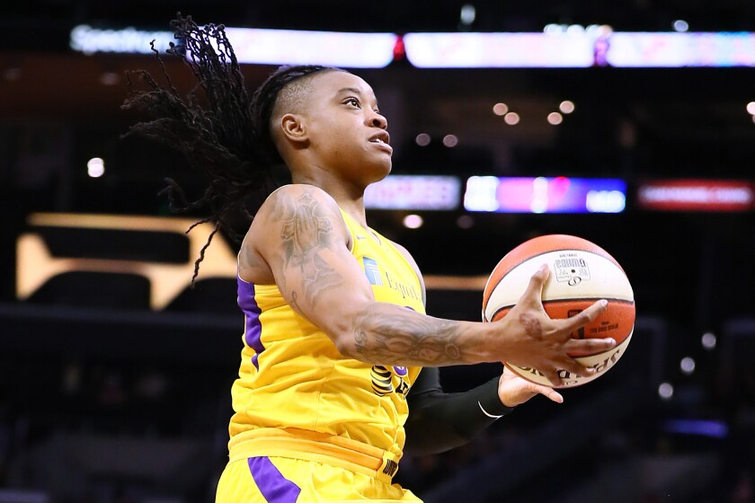 The Sparks' Riquna Williams drives to the basket during a game June 30, 2019.