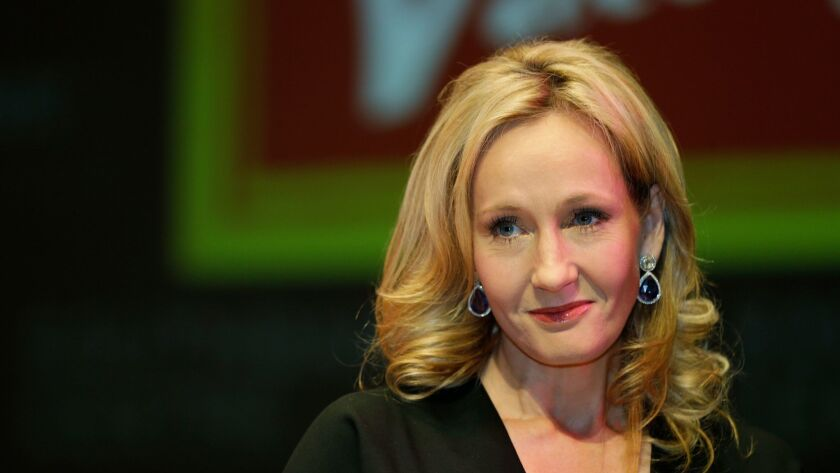 FILE- This is a Thursday, Sept. 27, 2012 file photo of British author J.K. Rowling as she poses for
