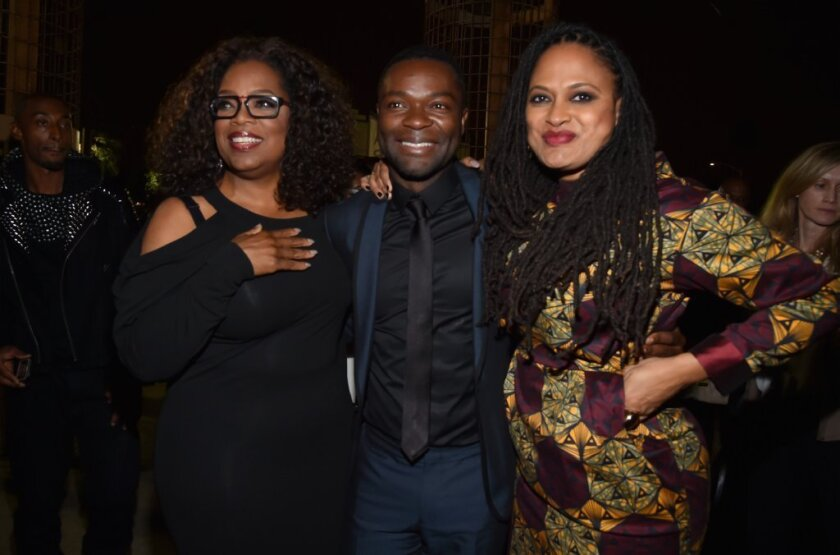 "Producer Oprah Winfrey, star David Oyelowo and director Ava DuVernay celebrate their film, ""Selma,"" at the AFI Fest in Hollywood on Nov. 11."