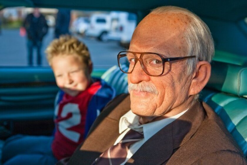 "Johnny Knoxville, right, and Jackson Nicoll star in ""Bad Grandpa,"" which is set to win the box office this weekend."
