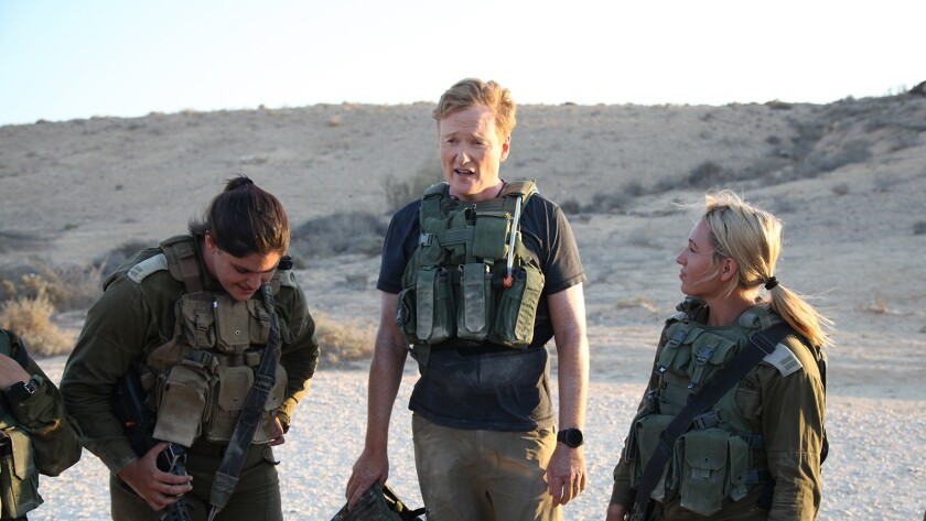 """Conan O'Brien, center, in """"Conan Without Borders: Israel """" on TBS."""