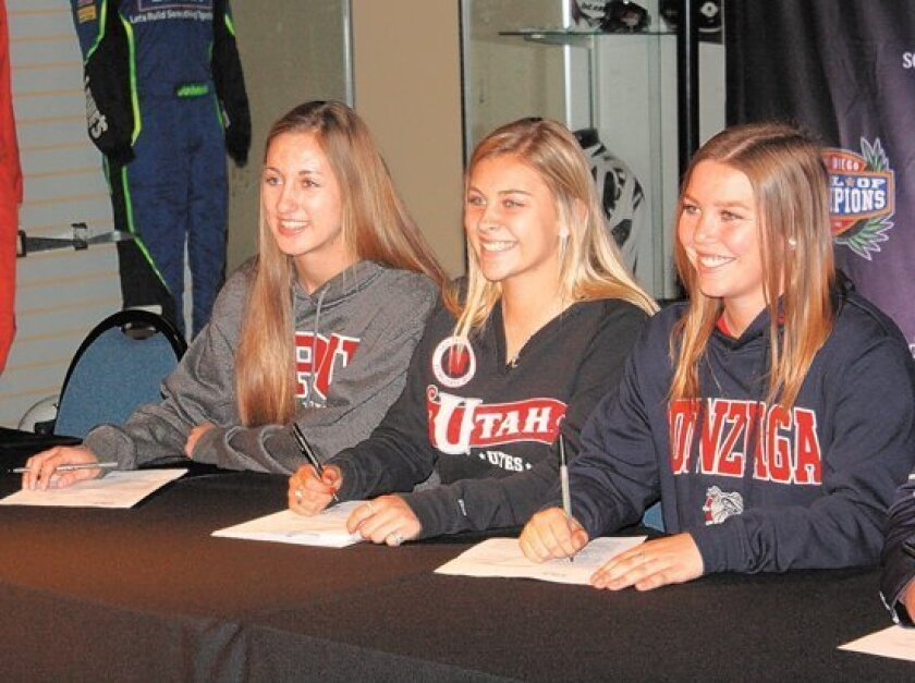 Poway girls soccer players ink their scholarships on National Signing Day last week. From left: Jill Godfrey, Liberty Taylor and Allie Seifert.