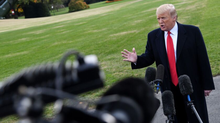 President Trump answers questions from the media as he departs the White House on Wednesday in Washington, D.C. Trump is attending a rally in Florida.