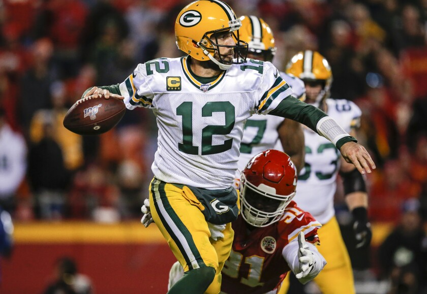 Packers quarterback Aaron Rodgers eludes Chiefs defensive end Derrick Nnadi during the third quarter of Green Bay's win Sunday.
