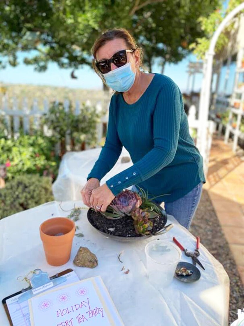 Poway Valley Garden Club member Donna Kaptain prepares a succulent design for the club's upcoming plant sale.
