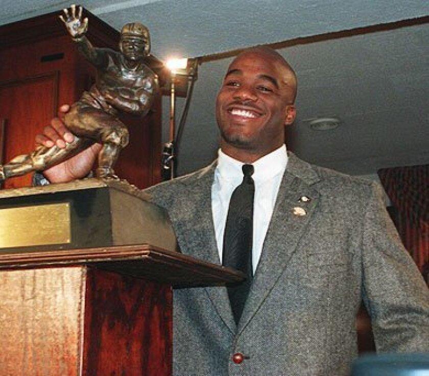 Rashann Salaam poses with the Heisman Trophy back in 1994.