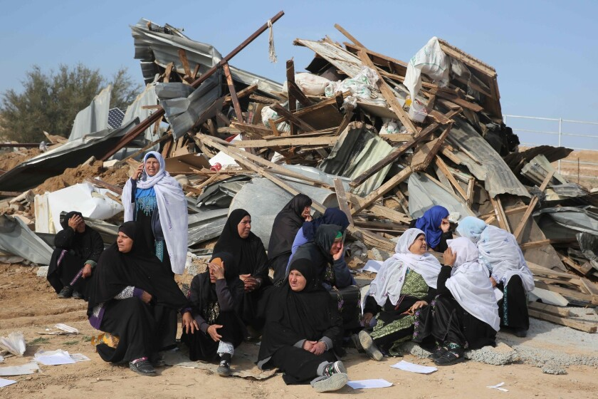 Bedouin women react to the destruction of houses in the Bedouin village of Um al Hiran, which is not recognized by the Israeli government.