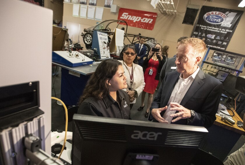 L.A. Unified School District Supt. Austin Beutner visits with Julia Melero, 17, at Van Nuys High in Los Angeles in May 2018.
