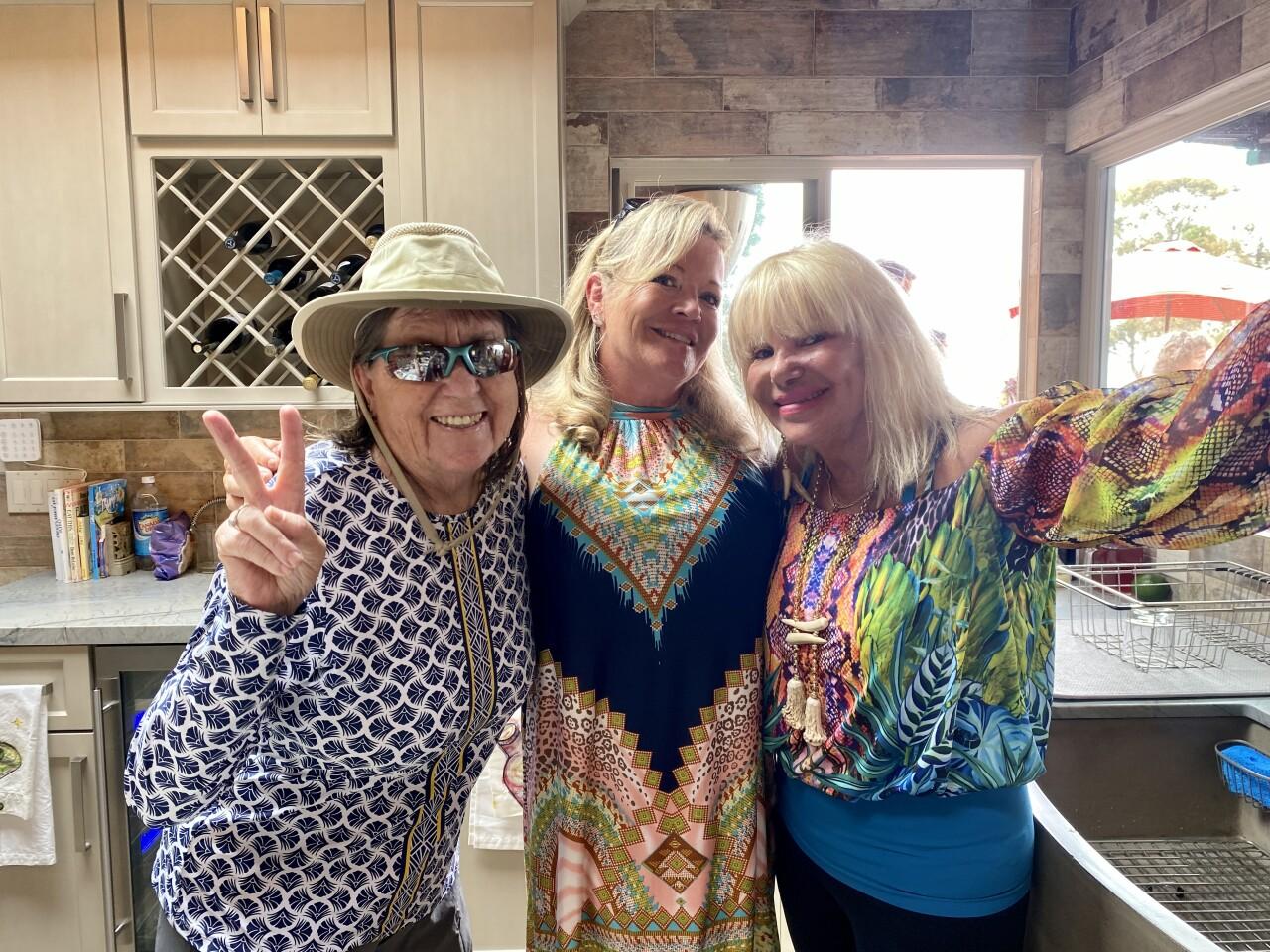 Jan Czarnecki, Sophia Richardson and Linda Mitchel Jimas gather at Mitchel Jimas' tennis happy hour July 28 in La Jolla.