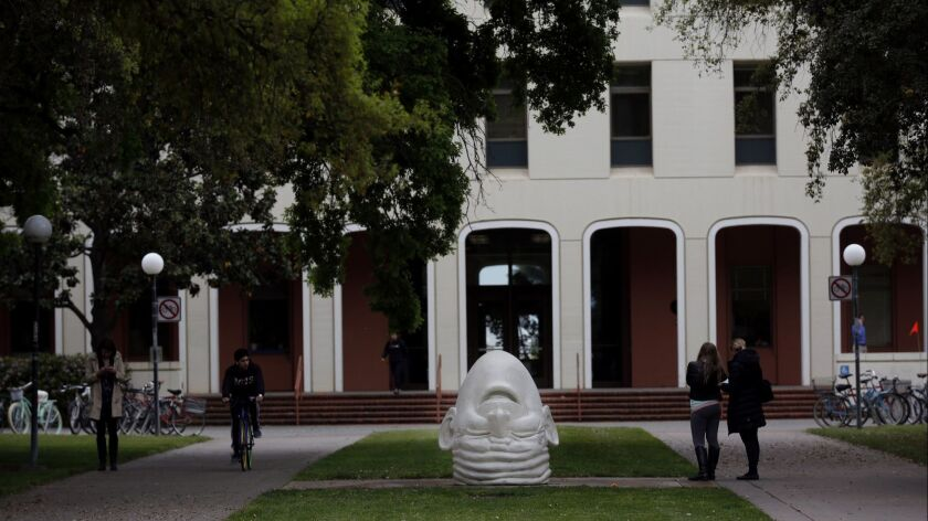 DAVIS, CA APRIL 11, 2017: An egghead sculpture in front of main administration building on the UC