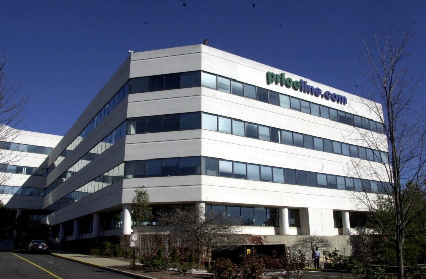 Priceline Group Inc., its headquarters pictured above, announced it would pay $2.6 billion to acquire OpenTable, a dining reservations booking company.