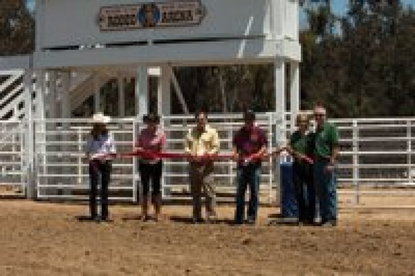 Cutting the Red Ribbon are Rancho Santa Fe residents Melisse Mossey and Camber Hardy, as well as Jeffrey Richardson, curator for the Gene Autry National Center, Rand Sperry, co-owner, and Tom and Val Ewan, operations directors.