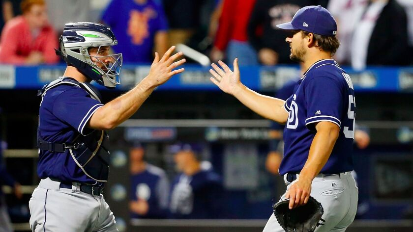 Brad Hand (right) and Austin Hedges of the San Diego Padres celebrate after the final out against the New York Mets at Citi Field on May 24, 2017.