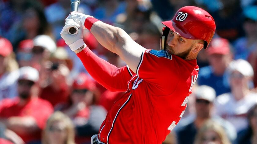 The Nationals' Bryce Harper bats during the first inning of an exhibition spring training baseball game against the Houston Astros Saturday, March 3, 2018, in West Palm Beach, Fla.