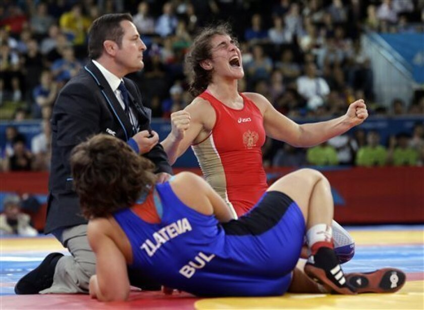 Natalia Vorobieva of Russia celebrates after beating Stanka Zlateva Hristova of Bulgaria for the gold medal during their 72-kg women's freestyle wrestling competition at the 2012 Summer Olympics, Thursday, Aug. 9, 2012, in London. (AP Photo/Paul Sancya)