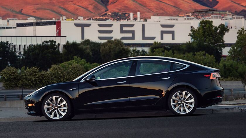 FILE - This file image provided by Tesla Motors shows the Tesla Model 3 sedan. Tesla is raising $1.5