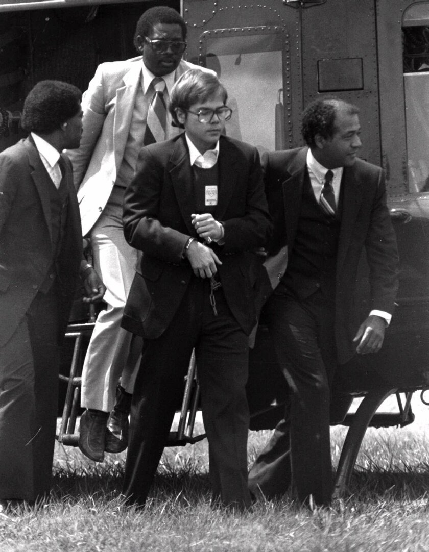 John W. Hinckley, Jr. is shown arriving in chains at Quantico Marine Base on Aug. 18, 1981.