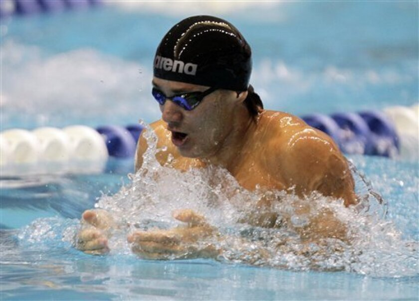 Marcus Titus swims 100-meter breaststroke on his way to winning the event at the Indianapolis Grand Prix swimming meet in Indianapolis, Saturday, March 31, 2012.  (AP Photo/Michael Conroy)