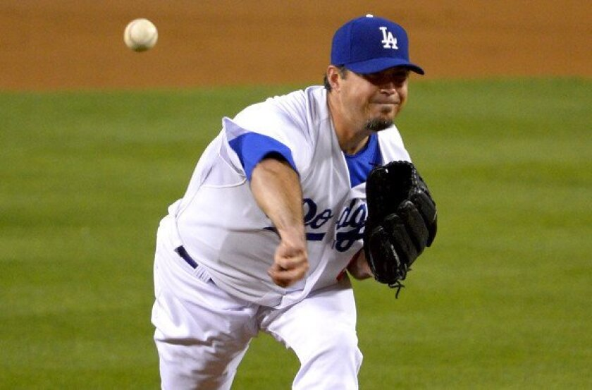 Josh Beckett became the sixth Dodgers starting pitcher to land on the disabled list this season.