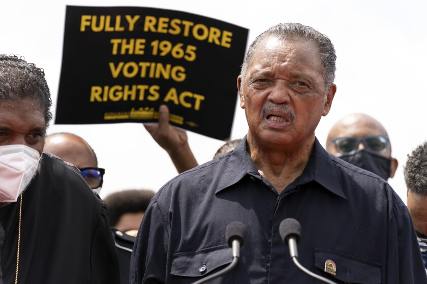 The Rev. Jesse Jackson speaks to a crowd during a voting rights demonstration on Capitol Hill.