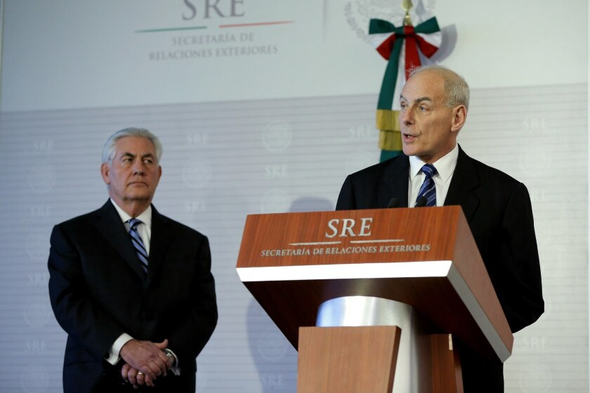 U.S. Secretary of Homeland Security John Kelly, right, and U.S. Secretary of State Rex Tillerson hold a news conference in Mexico City.