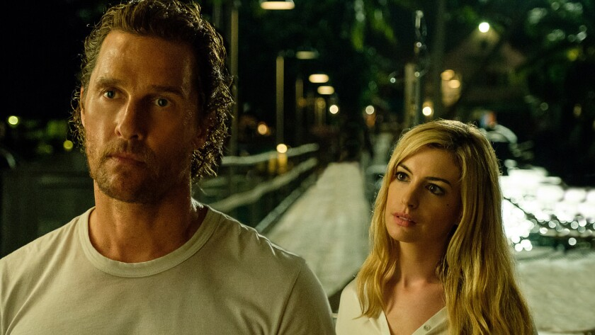 """Matthew McConaughey and Anne Hathaway in the movie """"Serenity."""""""
