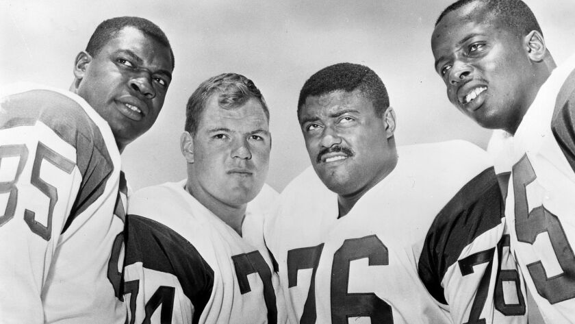 "The Rams' ""Fearsome Foursome"" from left to right are Lamar Lundy, Merlin Olsen, Rosey Grier, and Deacon Jones."