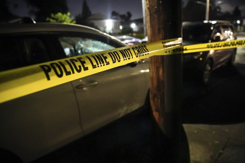 Portland police respond to a shooting in a house in the 4000 block of Southeast Boise Street, on Sunday evening, June 6, 2021. Homicide detectives also responded. (Mark Graves/The Oregonian via AP)