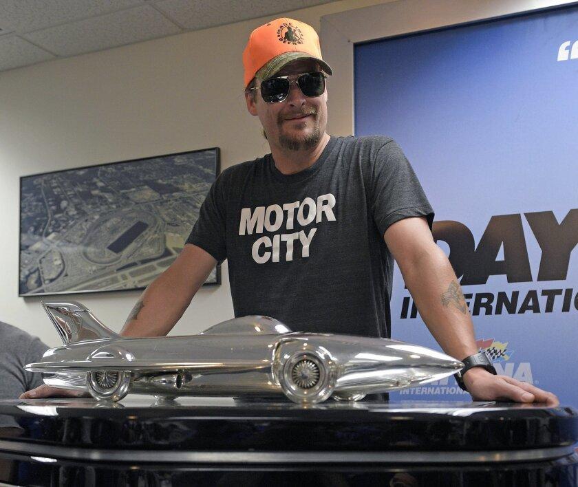 Kid Rock poses with the winner's trophy during a news conference before the Daytona 500 NASCAR Sprint Cup series auto race at Daytona International Speedway in Daytona Beach, Fla., Sunday, Feb. 22, 2015. (AP Photo/Phelan M. Ebenhack)