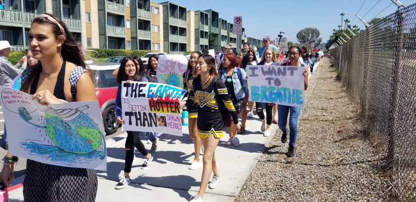 Climate-conscious students head to a rally at Kendall-Frost Mission Bay Marsh Reserve, Sept. 20.