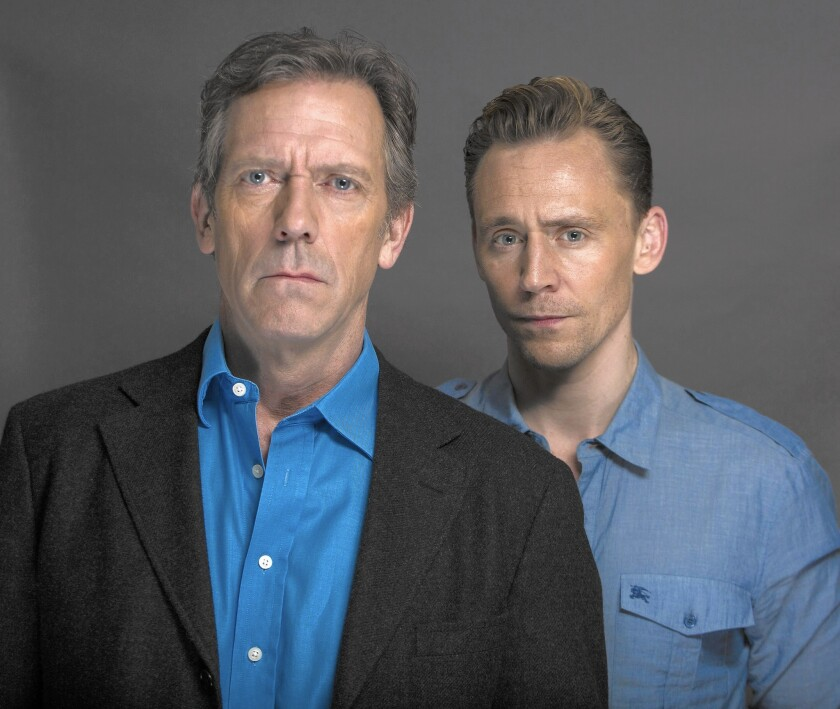 "Actors Hugh Laurie, left, and Tom Hiddleston looked to John Le Carré's work as their gospel for the AMC miniseries ""The Night Manager."""