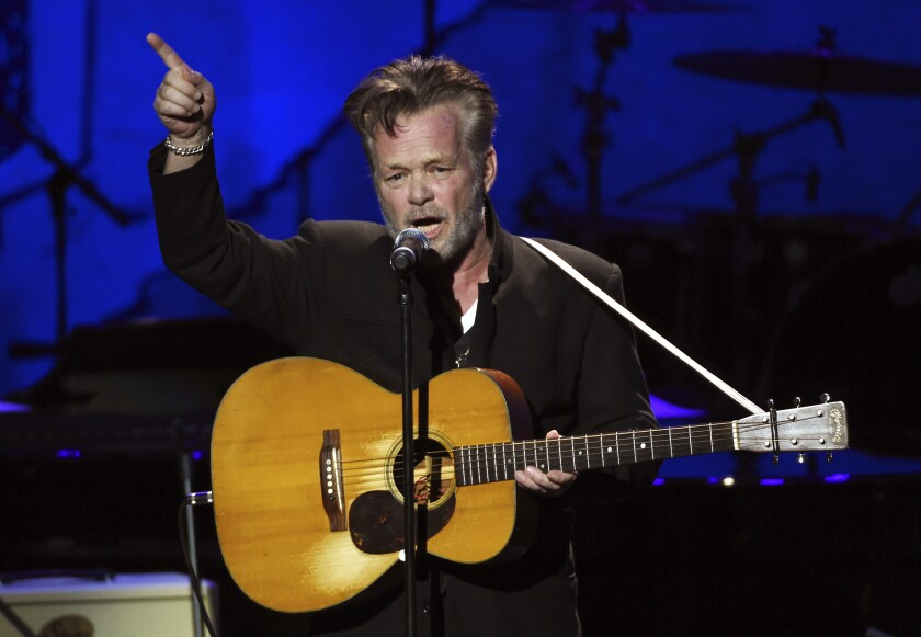 FILE - John Mellencamp performs at the 17th Annual GRAMMY Foundation Legacy Concert at the Wilshire Ebell Theatre on Thursday, Feb. 5, 2015, in Los Angeles. Mellencamp turns 70 on Oct. 7. (Photo by Chris Pizzello/Invision/AP, File)